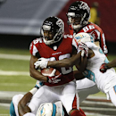 Miami Dolphins cornerback Will Davis (29) and Miami Dolphins running back Mike Gillislee (23) tackle Atlanta Falcons cornerback Josh Wilson (26) during the first half of an NFL preseason football game, Friday, Aug. 8, 2014, in Atlanta The Associated Press