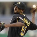 Pittsburgh Pirates starting pitcher James McDonald (53) throws against the St. Louis Cardinals in the second inning of the baseball game on Tuesday, Aug. 28, 2012, in Pittsburgh. (AP Photo/Keith Srakocic)