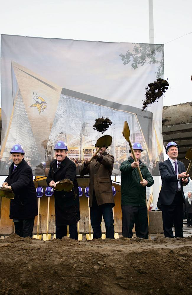 This photos shows the ceremonial groundbreaking for the new Vikings stadium on Tuesday, Dec. 3, 2013, in Minneapolis. After more than a decade of planning, dealing and pleading, the $1 billion project began Tuesday