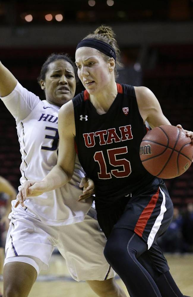 Utah's Michelle Plouffe (15) drives against Washington's Jazmine Davis in the first half of an NCAA college basketball game in the Pac-12 women's tournament Thursday, March 6, 2014, in Seattle