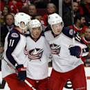 Columbus Blue Jackets center Ryan Johansen (19) celebrates his goal with teammates Matt Calvert (11) and Cam Atkinson (13) during the first period of an NHL hockey game against the Chicago Blackhawks, Thursday, March 6, 2014, in Chicago. (AP Photo/Charles Rex Arbogast)