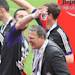 Belgium's RSC Anderlecht coach John Van Den Brom gets sprayed by champagne on the podium as RSC Anderlecht won the final soccer match of the Belgian League at the Constant Vanden Stock stadium in Brussels, Sunday, May 19, 2013. (AP Photo/Yves Logghe)