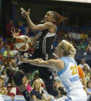 San Antonio Silver Stars' Danielle Robinson, left, is fouled by Chicago Sky's Courtney Vandersloot during the first half of an WNBA basketball game, Wednesday, July 11, 2012, in Rosemont, Ill. (AP Photo/Charles Rex Arbogast)