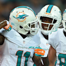 Miami Dolphins' Mike Wallace, left, reacts after scoring a touchdown during the NFL football game against Oakland Raiders at Wembley Stadium in London, Sunday, Sept. 28, 2014. The Associated Press
