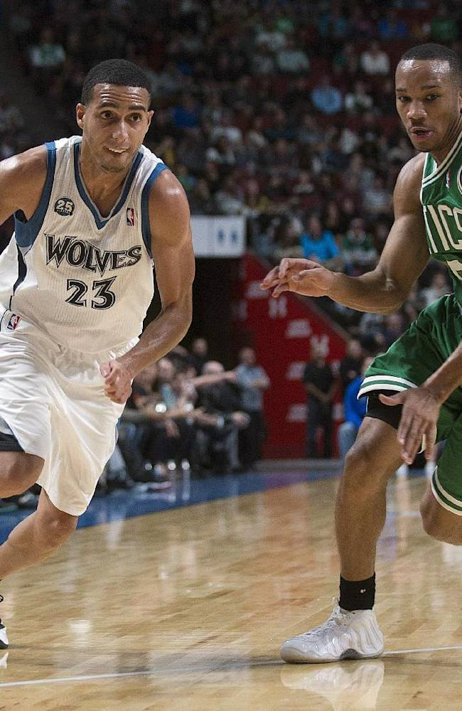 Minnesota Timberwolves' Kevin Martin, left, drives to the net as Boston Celtics' Avery Bradley defends during the third quarter of an NBA preseason basketball game in Montreal, Sunday, Oct. 20, 2013