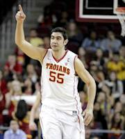 Southern California's Omar Oraby reacts after making a basket during the first half of an NCAA college basketball game against California on Wednesday, Jan. 22, 2014, in Los Angeles. (AP Photo/Jae C. Hong)