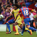 Chelsea's Willian, center, competes for the ball with Crystal Palace's Joel Ward, left, during their English Premier League soccer match at Selhurst Park, London, Saturday, Oct. 18, 2014