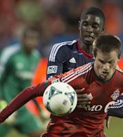Toronto FC 's Justin Braun shields the ball from Chicago Fire's Bakary Soumare during the first half of an MLS soccer game in Toronto on Wednesday, Sept. 11, 2013. (AP Photo/The Canadian Press, Chris Young)