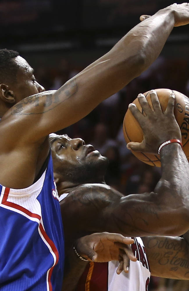Los Angeles Clippers' DeAndre Jordan, left, blocks a shot by Miami Heat's LeBron James during the first half of an NBA basketball game in Miami, Thursday, Nov. 7, 2013