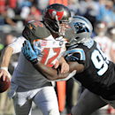 Tampa Bay Buccaneers' Josh McCown (12) is hit by Carolina Panthers' Charles Johnson (95) in the second half of an NFL football game in Charlotte, N.C., Sunday, Dec. 14, 2014 The Associated Press