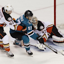 San Jose Sharks' Tommy Wingels (57) attempts to score as Anaheim Ducks' Josh Manson (42), left, and goalie Jason LaBarbara defend during the third period of an NHL hockey game, Saturday, Nov. 29, 2014, in San Jose, Calif. The Sharks beat the Ducks 6-4 The
