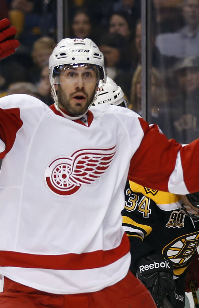 Detroit Red Wings' Drew Miller raises his arms as he looks for a penalty to be called against the Boston Bruins, during the first period of Game 1 of a first-round NHL playoff hockey series in Boston on Friday, April 18, 2014