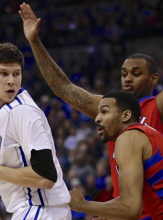 Creighton's Doug McDermott, left, is guarded by DePaul's DeJuan Marrero, front right, and DePaul's Tommy Hamilton IV, rear right, in the first half of an NCAA college basketball game in Omaha, Neb., Friday, Feb. 7, 2014