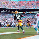 Green Bay Packers wide receiver Randall Cobb (18) grabs a touchdown pass during the second half of an NFL football game against the Miami Dolphins, Sunday, Oct. 12, 2014, in Miami Gardens, Fla The Associated Press