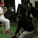 Philadelphia Phillies starting pitcher Cliff Lee, left, poses for photographers during the team's photo day before a spring training baseball practice Wednesday, Feb. 19, 2014, in Clearwater, Fla The Associated Press