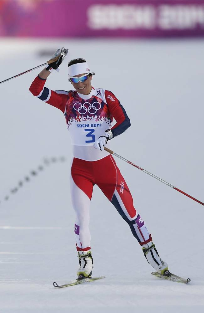 Norway's Marit Bjoergen skis toward the finish after falling during her women's semifinal heat of the cross-country sprint at the 2014 Winter Olympics, Tuesday, Feb. 11, 2014, in Krasnaya Polyana, Russia