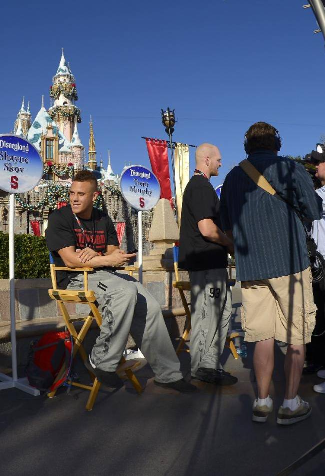 Stanford running back Tyler Gaffney, left, and linebacker Shayne Skov talk as other players are interviewed as the Stanford and Michigan State football teams visited Disneyland, Thursday, Dec. 26, 2013, in Anaheim, Calif. Stanford and Michigan State are scheduled to play in the Rose Bowl on New Year's Day
