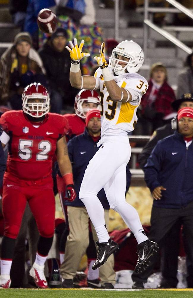 Wyoming widereceiver Dominic Rufan (33) leaps for the ball Saturday, Nov. 9, 2013 at War Memorial Stadium in Laramie, WY against Fresno St