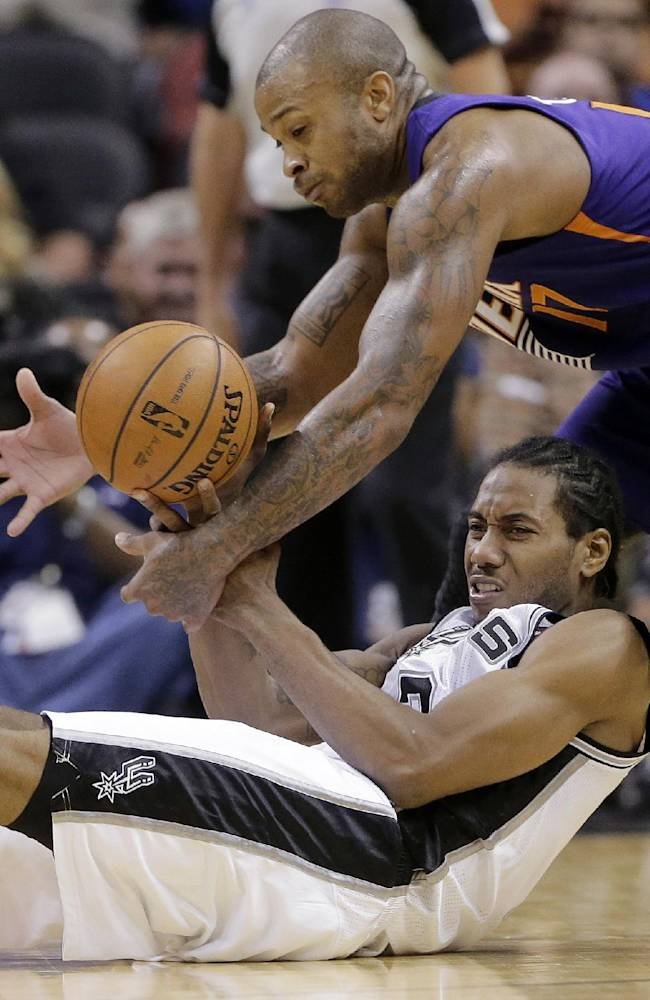 Parker leads Spurs to hectic win over Suns