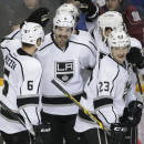 Los Angeles Kings defenseman Drew Doughty (8) celebrates with Jake Muzzin (6) and Dustin Brown (23) after scoring against the Nashville Predators in the third period of an NHL hockey game Tuesday, Nov. 25, 2014, in Nashville, Tenn. The Predators won 4-3 in a shootout. (AP Photo/Mark Humphrey)