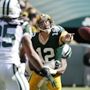 Green Bay Packers' Aaron Rodgers throws the ball as he is hit during the first half of an NFL football game against the New York Jets Sunday, Sept. 14, 2014, in Green Bay, Wis The Associated Press
