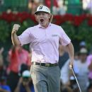 Brandt Snedeker of the U.S., reacts after winning the Tour Championship and the FedEx Cup on the 18th green during the final round of the Tour Championship golf tournament at the East Lake Golf Club in Atlanta, Georgia, September 23, 2012. REUTERS/Tami Chappell