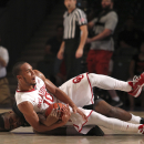 Oklahoma's Jordan Woodward, top, and Butler's Kelan Martin battle for to control of the ball during Game 5 of the Battle 4 Atlantis basketball tournament in Paradise Island, Bahamas, Thursday, Nov. 27, 2014. (AP Photo/Tim Aylen)