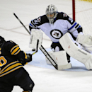 Buffalo Sabres left winger Matt Moulson (26), shoots the puck against Winnipeg Jets goaltender Ondrej Pavelec (31), of the Czech Republic, during the third period of an NHL hockey game Wednesday, Nov. 26, 2014, in Buffalo, N.Y. Winnipeg won 2-1 The Associ