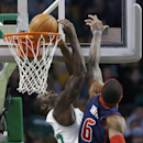 Boston Celtics' Brandon Bass, left, scores in front of Detroit Pistons' Josh Smith (6) in the first quarter of an NBA basketball game in Boston, Sunday, March 9, 2014 The Associated Press