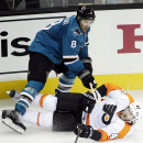 San Jose Sharks center Joe Pavelski, top, collides with Philadelphia Flyers defenseman Andrew MacDonald during the third period of an NHL hockey game Tuesday, Dec. 2, 2014, in San Jose, Calif. San Jose won 2-1 The Associated Press