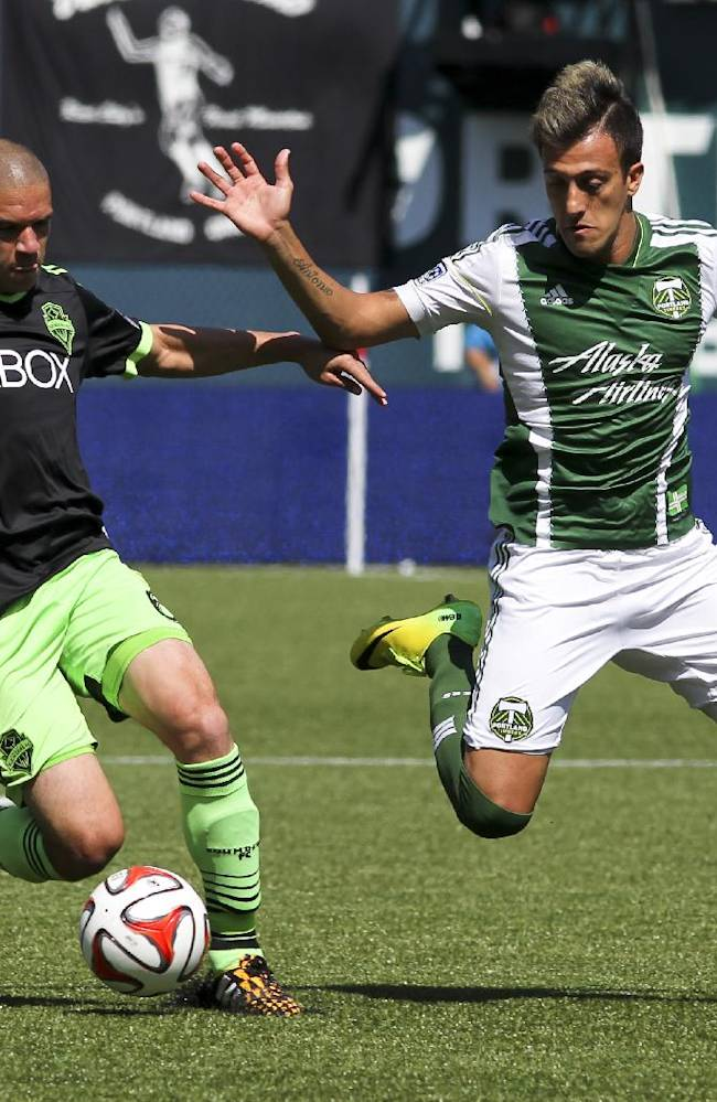 Portland Timbers' Maximiliano Urruti right, and and Seattle Sounders' Osvaldo Alonso, left, vie for control of the ball during an MLS soccer game in Portland, Ore., Sunday, Aug. 24, 2014