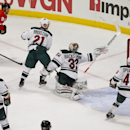 Chicago Blackhawks center Brad Richards (91) scores past Minnesota Wild goalie Niklas Backstrom (32) during the second period of an NHL hockey game in Chicago, Sunday, Jan. 11, 2015 The Associated Press