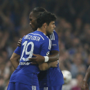 Chelsea's Didier Drogba is substituted by Diego Costa, front, during the Champions League group G soccer match between Chelsea and Schalke 04 at Stamford Bridge stadium in London, Wednesday, Sept. 17, 2014