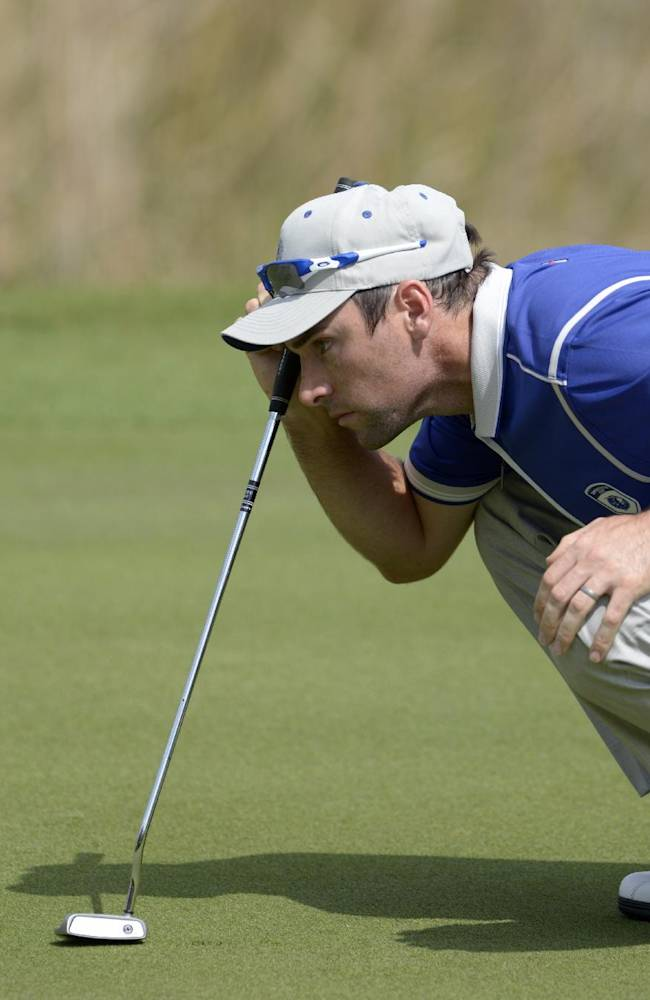 Lake Nona team member Oliver Wilson, of England, lines up his putt on the seventh green during the second day of the Tavistock Cup golf tournament  in Windermere, Fla., Tuesday, March 15, 2011