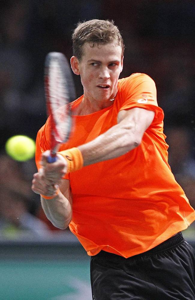 Canadian player Vasek Pospisil  returns the ball to Spain's Pablo Andujar, during their second round match, at the Tennis Paris Masters, in the Paris Bercy stadium, Tuesday Oct. 29, 2013