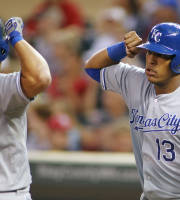 Kansas City Royals' Mike Moustakas, left, celebrates with Salvador Perez after hitting a three-run home run off Minnesota Twins pitcher Mike Pelfrey in the third inning of a baseball game in Minneapolis Tuesday, July 30, 2013. (AP Photo/Andy King)