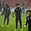 Real Madrid's Cristiano Ronaldo, center, reacts as he stands in heavy rain shower as he trains with teammates at Anfield Stadium, in Liverpool, England, Tuesday, Oct. 21, 2014. Real Madrid will play Liverpool in a Champion's League Group B soccer match on