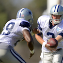 Dallas Cowboys quarterback Brandon Weeden, right, hands off to running back DeMarco Murray during the NFL football team's training camp, Saturday, July 26, 2014, in Oxnard, Calif The Associated Press