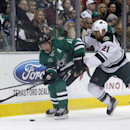 Dallas Stars left wing Ray Whitney (13) and Minnesota Wild center Kyle Brodziak (21) vie for the puck during an NHL hockey game in Dallas on Saturday, March 8, 2014 The Associated Press