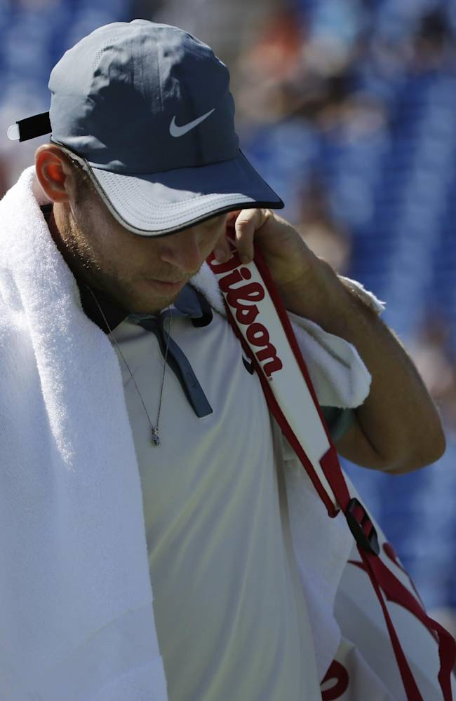 Dudi Sela, of Israel, walks off the court after losing to Grigor Dimitrov, of Bulgaria, during the second round of the 2014 U.S. Open tennis tournament, Friday, Aug. 29, 2014, in New York