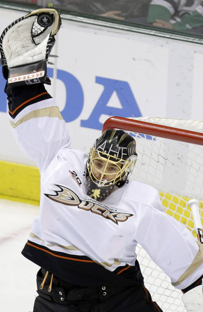Anaheim Ducks goalie Jonas Hiller catches the puck during the second period of Game 6 of a first-round NHL hockey playoff series against the Dallas Stars in Dallas, Sunday, April 27, 2014