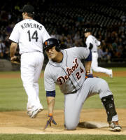 Detroit Tigers' Miguel Cabrera grimaces as he gets up from first after sliding into the base for the third out during the 11th inning of a baseball game and 4-3 loss to the Chicago White Sox. Tuesday, Aug. 13, 2013, in Chicago. (AP Photo/Charles Rex Arbogast)