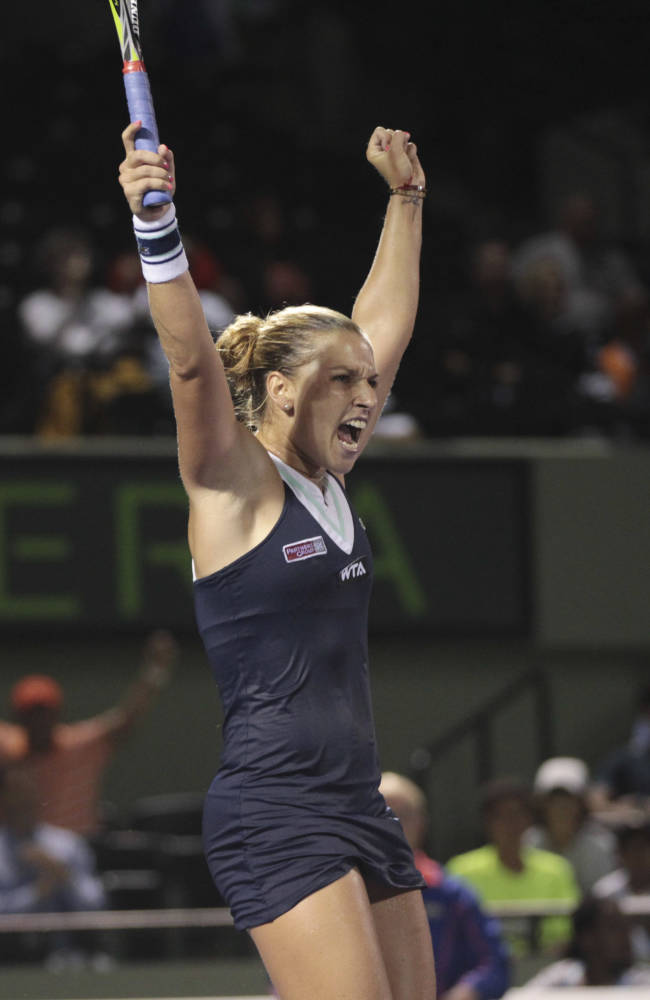 Dominika Cibulkova, of Slovakia, reacts after winning her match against Venus Williams, of the United States, during the Sony Open Tennis in Key Biscayne, Fla., Monday, March 24, 2014. She won 6-1, 7-5, 6-3