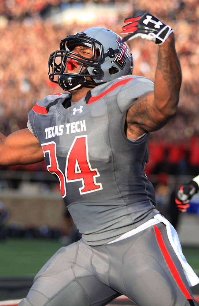 Texas Tech's Kenny Williams celebrates a touchdown against TCU during their NCAA college football game in Lubbock, Texas, Thursday, Sept. 12, 2013