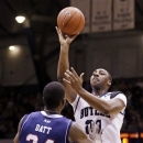 Butler forward Roosevelt Jones, right, shoots over Duquesne's Mamadou Datt during the first half of an NCAA college basketball game in Indianapolis, Tuesday, Feb. 19, 2013. (AP Photo/Michael Conroy)