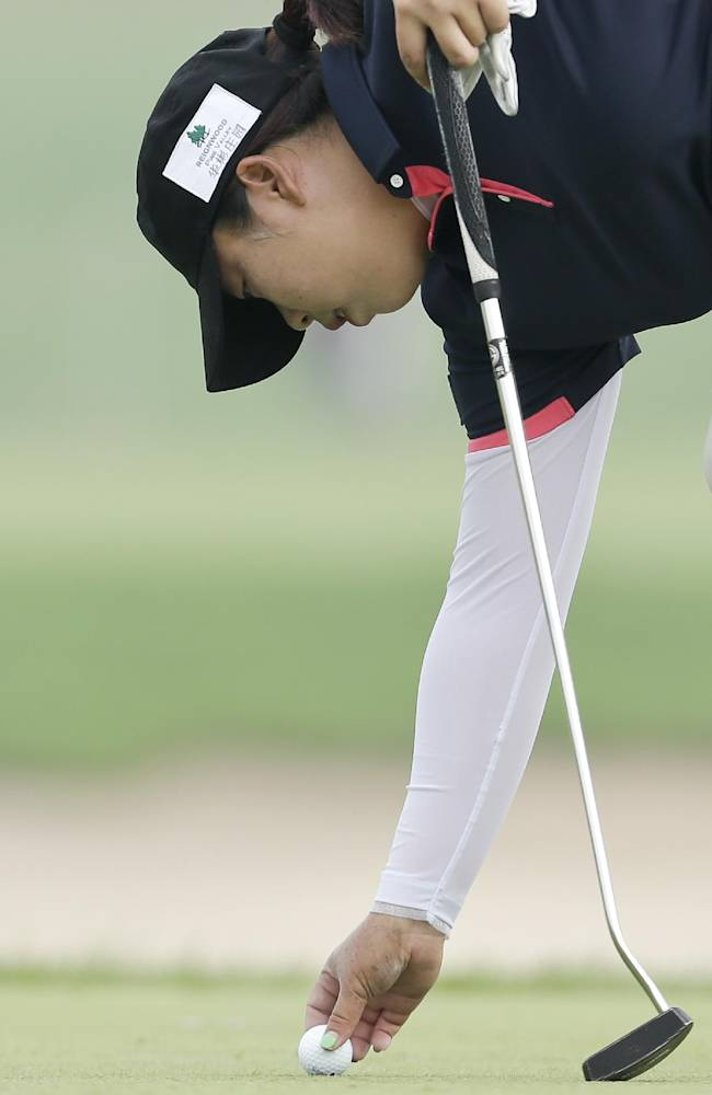 China's Shanshan Feng sets her ball down on the third green during the second round of the Reignwood LPGA Classic golf tournament at Pine Valley Golf Club on the outskirts of Beijing, China, Friday, Oct. 4, 2013