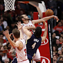 Chicago Bulls center Joakim Noah (13) blocks the shot of Indiana Pacers forward Luis Scola (4) as Mike Dunleavy (34) watches during the first half of an NBA basketball game Monday, March 24, 2014, in Chicago The Associated Press