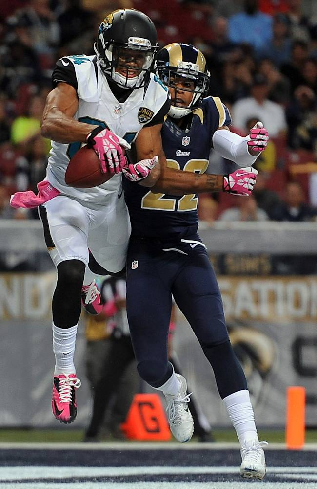 Jacksonville Jaguars wide receiver Cecil Shorts, left, catches a 4-yard pass for a touchdown as St. Louis Rams cornerback Trumaine Johnson defends during the fourth quarter of an NFL football game Sunday, Oct. 6, 2013, in St. Louis