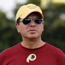 In this July 27, 2014 file photo, Washington Redskins owner Daniel Snyder pauses on the field after football practice at the team's NFL football training facility in Richmond, Va. A long-running dispute over the Washington Redskins' team name will likely
