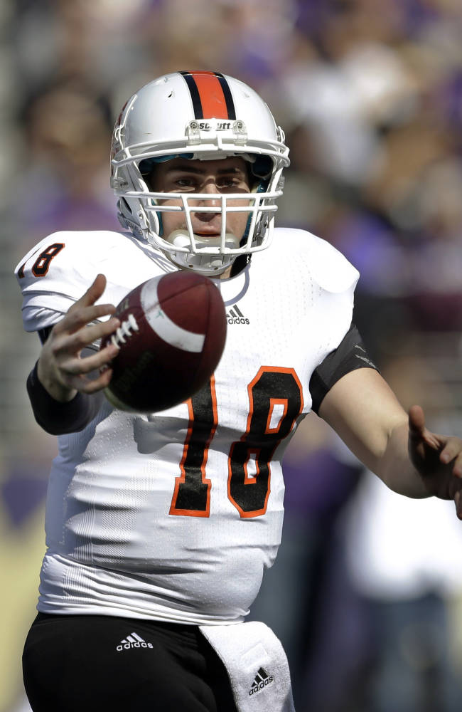 Idaho State quarterback Justin Arias tries to get a grip on the ball during the first half of an NCAA college football game against Washington Saturday, Sept. 21, 2013, in Seattle